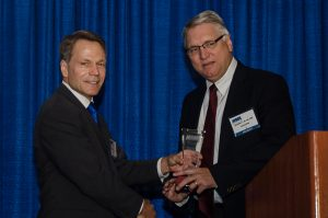 2015-16 KMA President Ted Miller, M.D., PhD, presented Sheldon Bond, M.D., FACS, of Louisville with the KMA Educational Achievement Award during the Kentucky Physicians Leadership Academy at the KMA Annual Meeting Saturday. Photo by Mary Branham for KMA.