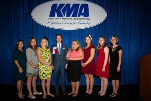 Shawn Jones, M.D., fourth from left, a Paducah otolaryngologist who was presented with the KMA Distinguished Service Award Saturday night, complimented the Middlesboro students who worked to get a smoking ban passed and were recognized with the KMA Debra K. Best Outstanding Layperson Award. Pictured with Dr. Jones are teachers Tonya Martin, left, and Kelsey Massengill, right, and students Haylee Mills, Chloe Burchett, Ryann Tong, Sabrina Sparks and Kaylea Martin. Photo by David Knapp for KMA.