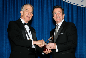 2015-16 KMA President Ted Miller, M.D., PhD, presented Shawn Jones, M.D., of Paducah with the Distinguished Service Award during the Leadership Dinner at the KMA Annual Meeting. Jones was also recognized as as KMA Community Connector. Photo by David Knapp for KMA.